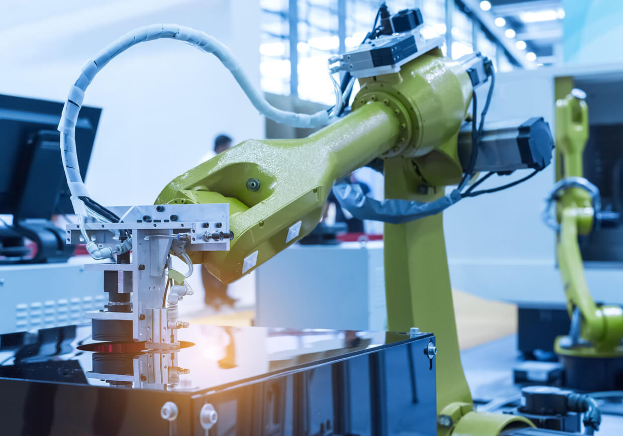 Dynamic Electrical Systems Australia - Local Electricians Adelaide. Image of industrial robots in production line.